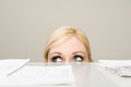Woman behind filing cabinet Royalty Free Stock Photo