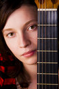 Woman behind fretboard Royalty Free Stock Photo