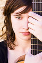 Woman behind guitar fretboard Royalty Free Stock Photo