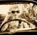 Woman behind steering wheel Royalty Free Stock Photo