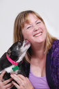 Woman being kissed by dog Royalty Free Stock Image