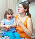 Woman berates crying baby Stock Images