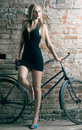 Woman with a bicycle Stock Photo