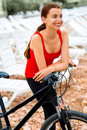 Woman with bicycle on the beach young sport standing Stock Images