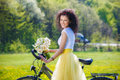 Woman With A Bicycle In Nature