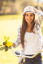 Woman bicycle outdoor cheerful young in a with flowers Royalty Free Stock Images