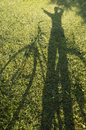 Woman and bicycle shadow from a standing waving with a Stock Photo