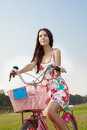 Woman on bicycle young with outside in the park Stock Photos