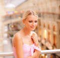 Woman in big hall at handrail Stock Photos