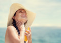 Woman in big straw hat enjoy with summer sun Royalty Free Stock Photo