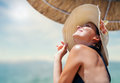 Woman in big straw hat enjoyed with summer sun Royalty Free Stock Photo