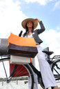 Woman on bike g bags Stock Images