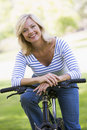 Woman on bike outdoors smiling Royalty Free Stock Photography