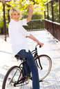 Woman bike waving cheerful middle aged in a goodbye Stock Photo