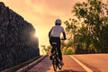 Woman biking uphill road Royalty Free Stock Photo