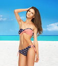 Woman in bikini with american flag Stock Image