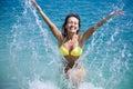 Woman in bikini bathing in sea Stock Photography