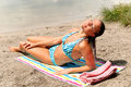Woman bikini  beach sunbathing Royalty Free Stock Images
