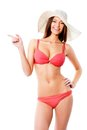 Woman in bikini beautiful shows on white background Royalty Free Stock Photography