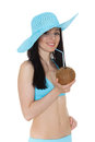 Woman in bikini with coconut portrait of young beautiful and sunhat cocktail on a white background tropical vacation Stock Photos