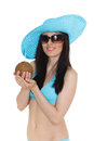 Woman in bikini with coconut portrait of young beautiful and sunhat cocktail on a white background tropical vacation Royalty Free Stock Images
