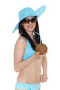 Woman in bikini with coconut portrait of young beautiful and sunhat cocktail on a white background tropical vacation Stock Image