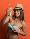 Woman in bikini with a cold drink pretty stylish girl holding Royalty Free Stock Photography