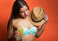 Woman in bikini with a cold drink pretty stylish girl holding Royalty Free Stock Images