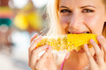 Woman in bikini eating corn summer and heat close up of face of Stock Images