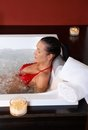 Woman in bikini in jacuzzi Stock Photo