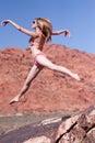 Woman in bikini jumping outdoors Royalty Free Stock Photo