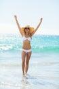 Woman in bikini jumping in water Royalty Free Stock Photo