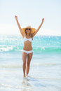 Woman in bikini jumping in water Royalty Free Stock Photo