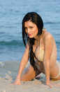 Woman in bikini lie down on sandy beach Royalty Free Stock Photo