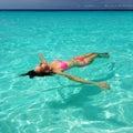 Woman in bikini lying on water Royalty Free Stock Photo