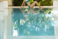 Woman in bikini relaxing by swimming pool low section of young Stock Photo