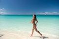 Woman in bikini running on beach Royalty Free Stock Photo