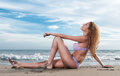 Woman in bikini on the sand under blue Royalty Free Stock Photography