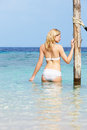 Woman in bikini standing in beautiful tropical sea happy Royalty Free Stock Photography