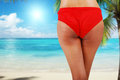 Woman in bikini walking on beach close up of the sun Royalty Free Stock Photos