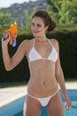 Woman in bikini with water gun Royalty Free Stock Photo