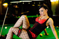 Woman on billiard table Royalty Free Stock Photos