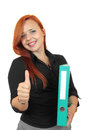 Woman with binder and thumbs up beautiful redhead business showing everything is ok Stock Photo