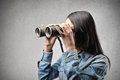 Woman with a binoculars looking at something through Royalty Free Stock Photos