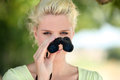 Woman with binoculars observing nature Stock Photo