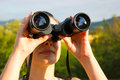 Woman with binoculars young watching birds in nature photography Royalty Free Stock Image