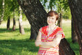 Woman by a birch tree Stock Images