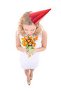 Woman in birthday cap with flowers white dress and isolated on white background Royalty Free Stock Images