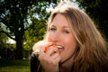 Woman biting an apple Royalty Free Stock Photo