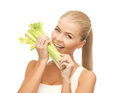 Woman biting piece of celery or green salad picture Stock Image